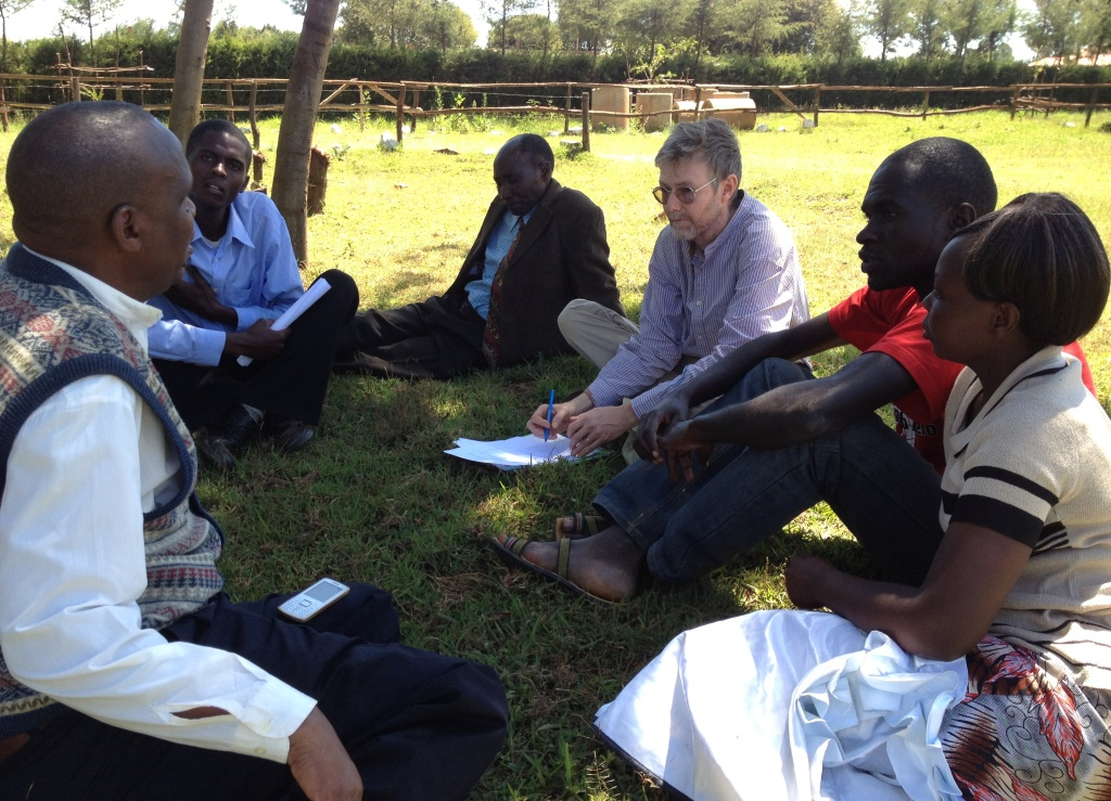 During a small group meeting, Joseph Wainaina (left) explains his part in coordinating the Peace Caravan in Eldoret (Photo: Gunilla Hamne)