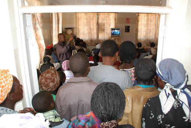 People crowd in to watch 'An African Answer' in Burnt Forest