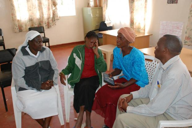 Sister Macrina Cheruto from the International Organization for Migration and Joseph Wainaina from Initiatives of Change offer counsel to Leah Muthoni (second left), a victim of the post-election violence, and Cecilia Kimemia, after the film screening.
