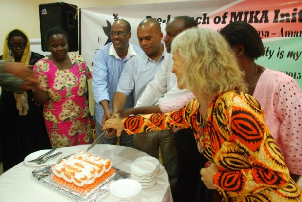 Ceremonial cutting and sharing of a large chocolate cake at the end of the occasion.