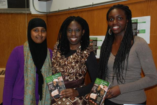 Members of the newly formed I of C Club at Ottawa University selling multimedia resource packages