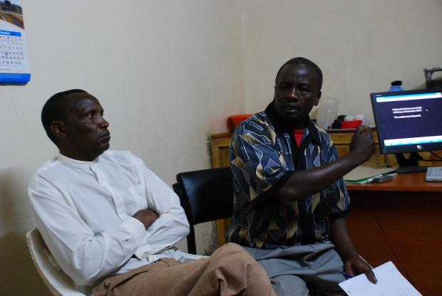 IofC worker Joseph Wainaina and Catholic Justice and Peace Commissioner Paul Keitany introduce a viewing of 'An African Answer' in the Rift Valley town of Kabarnet.