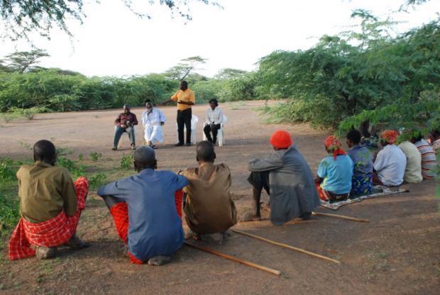 IofC project co-ordinator Joseph Karanja introduces Pastor James Wuye and Imam Muhammad Ashafa to a group of Ilchamus IDPs.
