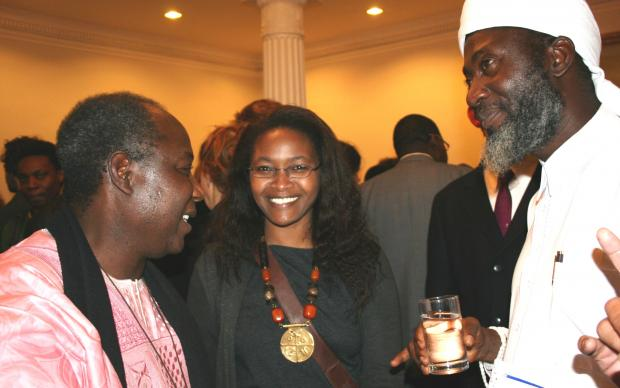 Pastor James Wuye, left, and Imam Muhammad Ashafa, right, with Wanjiku Kibunja from Kenya