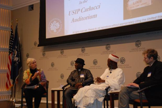 USIP: Maureen Fiedler moderating launch at USIP with Imam Ashafa and Pastor Wuye and Film Director Dr Alan Channer