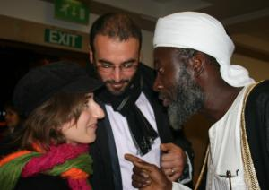 Imam Muhammed Ashafa talks with film producter Dr Imad Karam and his wife Amira (Photo: Louise Jefferson)