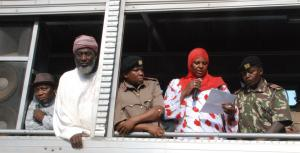 Workshop participant Aysha Dafalla reads a Peace Declaration from an open-air truck at the scene of the bomb blast in Eastleigh. Also present, from left to right, Pastor James Wuye, Imam Muhammad Ashafa, District Commissioner Omar Beja and District Commisioner George Natembeya.