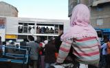 Residents of Eastleigh gather to listen to prayers and messages of peace at the scene of the blast